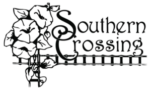 Crossing railroad tracks with flower growing on them